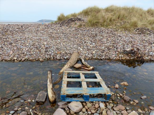 Makeshift bridge over Diles Lake stream on Rhossili beach