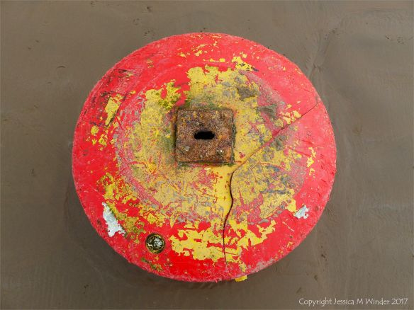 Wrecked mooring buoy on the sand at Rhossili
