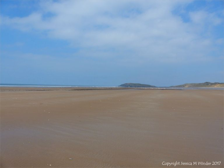 Looking north on Rhossili beach towards Burry Holms