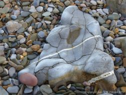Rocks and pebbles near Twlc Point at Broughton Bay on the Gower Peninsula in South Wales
