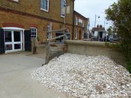 Modern oyster shell midden by the Royal Native Oyster Stores in Whitstable
