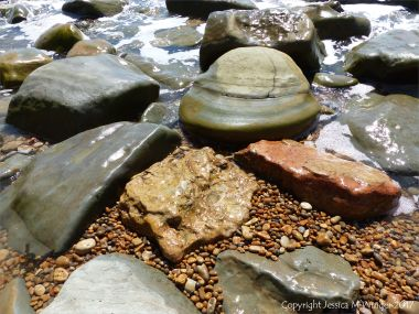 Boulders of various Jurassic rock types at Seatown in Dorset