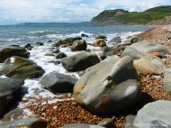Boulders on the water's edge at Seatown in Dorset