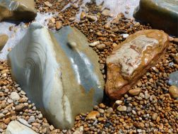 Boulders on the beach at Seatown on the Jurassic Coast