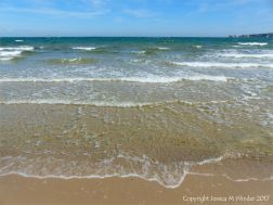 Sea, sand, and blue sky at Studland Bay in Dorset.