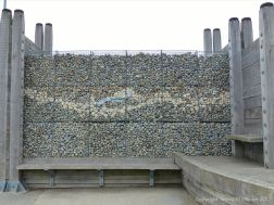 The Deck at Dead Man's Corner made with pebble-filled gabions