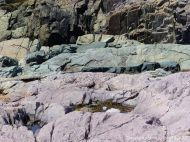 Rock texture in compacted volcanic ash or tuff and intrusive solidified lava