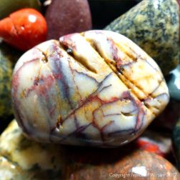 White pebble with red and yellow staining