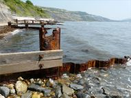 Rusting ironwork on a wooden breakwater