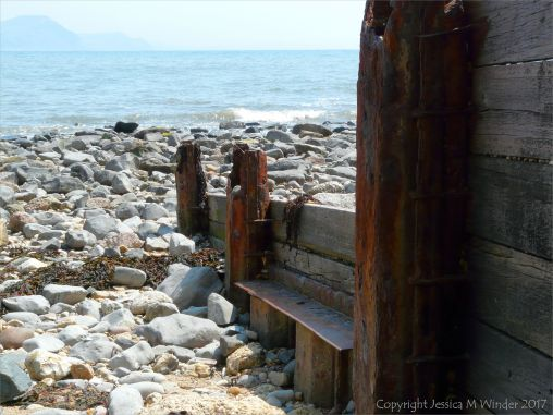 Remnants of an old wood and iron breakwater on the seashore