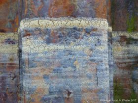 Dried seafoam on rusty iron