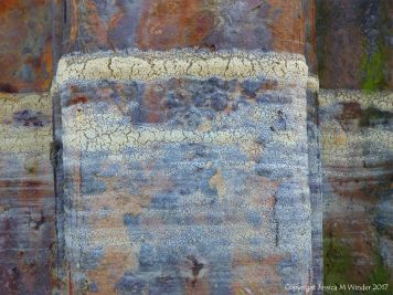 Dried seafoam on rusty iron