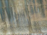 Natural pattern of staining on an old concrete sea wall