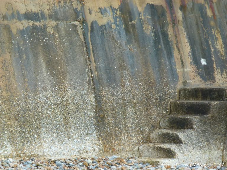 Concrete sea wall and steps for climbing over the breakwaters