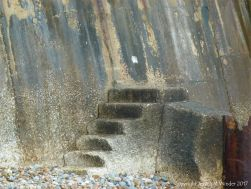 Natural pattern of stains on a concrete sea wall