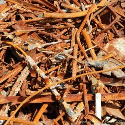 Pile of rusty metal junk on the beach