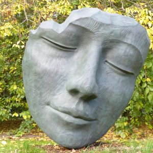 """The Fallen Deodar"" sculpture of a sleeping head by Jilly Sutton at Kew Gardens"