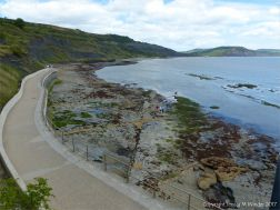 View looking down on the rocky shore below the new sea wall walkway at Lyme Regis