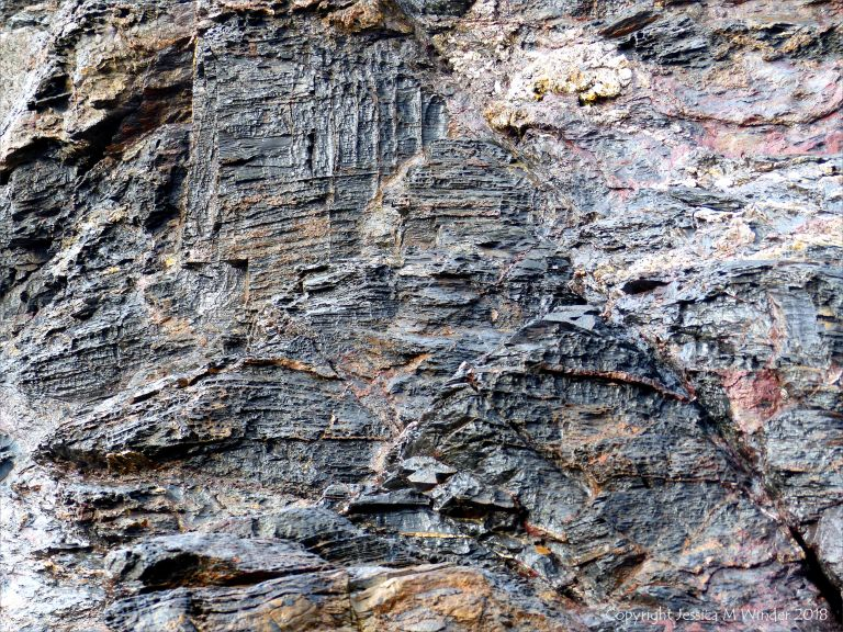 Wet rock-face texture and pattern in slate