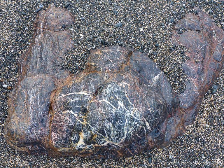 Rock outcrop on the beach at Polurrian Cove