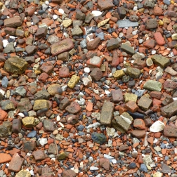 Detail of building and domestic debris on an urban beach along the River Thames in London