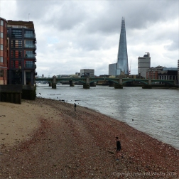 View looking east from the foreshore on the north bank of the Thames near the Millennium Bridge.