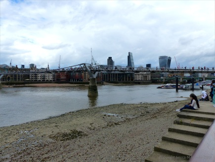 View of the Thames foreshore at low tide from the South Bank in London