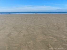 Rhossili Beach on a summer day showing patterns on the golden sand