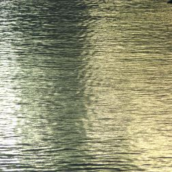 Reflected golden light on the surface of water