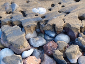 Beach pebbles covered with sand