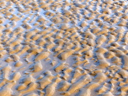 Natural patterns in the sand on the beach