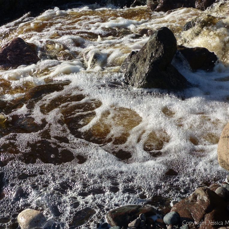 A torrent of water flowing in a Cornish stream