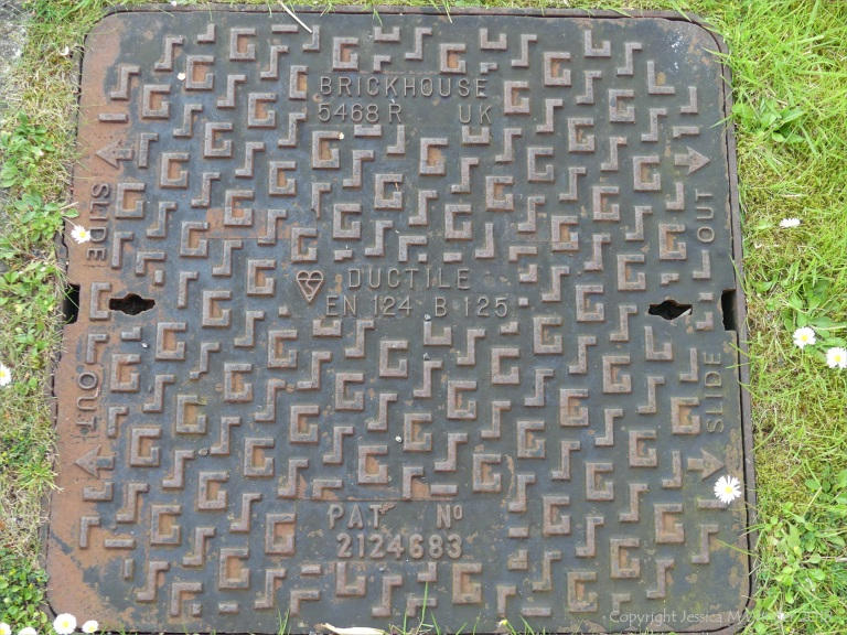 Manhole cover with chevron style markings