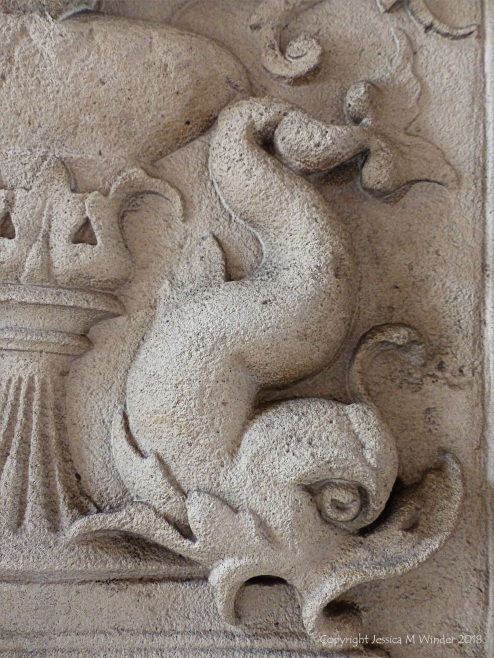 Stone carving of a dolphin
