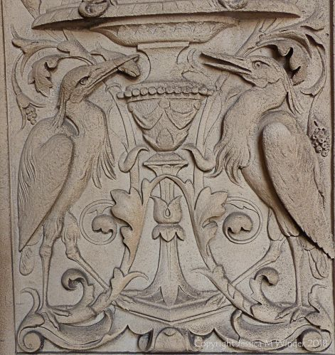 Stone carving of herons