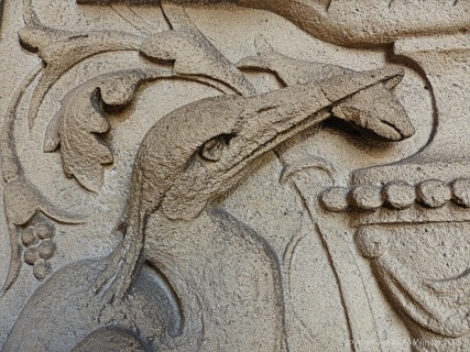 Stone carving of a heron