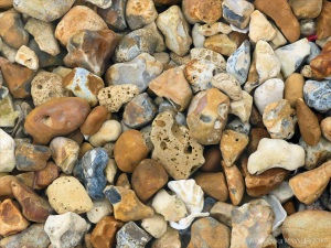 Beach stones with natural holes