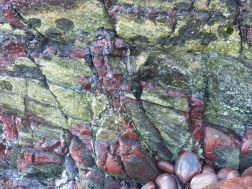 Close-up image serpentine rock (bastite serpentinite?)