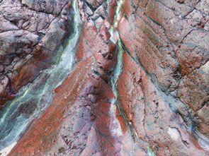 Close-up image red serpentine rock