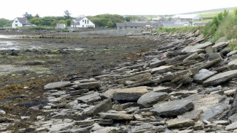 View looking east along the shore at Finstown showing flagstones