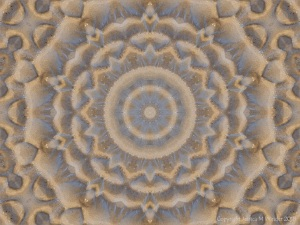 Mandala pattern with sand