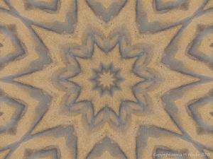 Mandala pattern with sand
