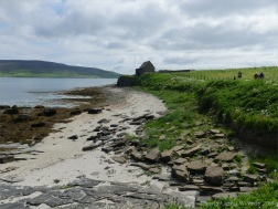 Looking east from Point of Hellia in Orkney towards Broch of Gurness and visitor centre