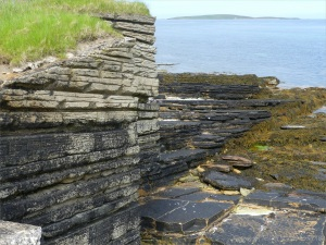 The artificial concrete cliffs and the real flagstone at Point of Hellia in Orkney