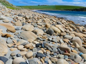 Beach stones at the west end of Dingieshowe Bay