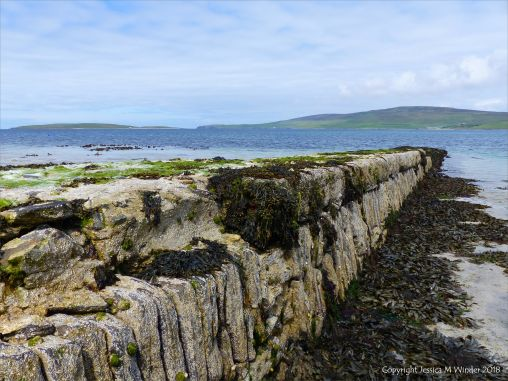 East vertical face of stonework pier at Grit Ness in Orkney