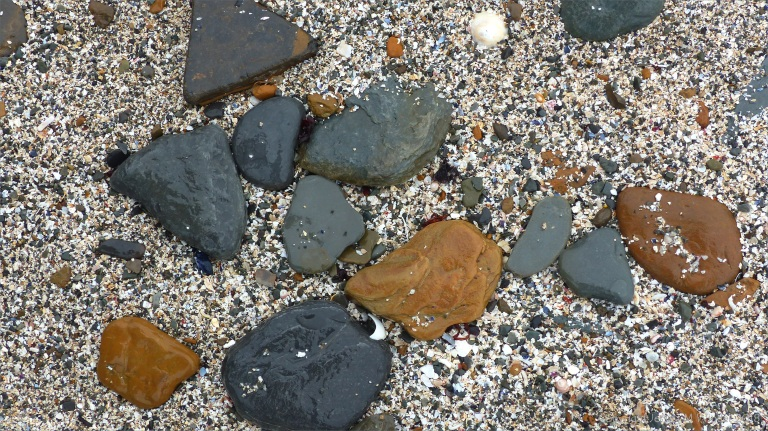 Beach stones and shell sand at Birsay causeway
