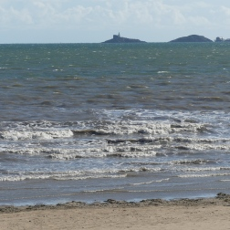 Waves at Swansea Bay with Mumbles in background