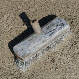 Broken deck broom washed ashore