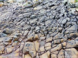 Cracked rock pavement on seashore
